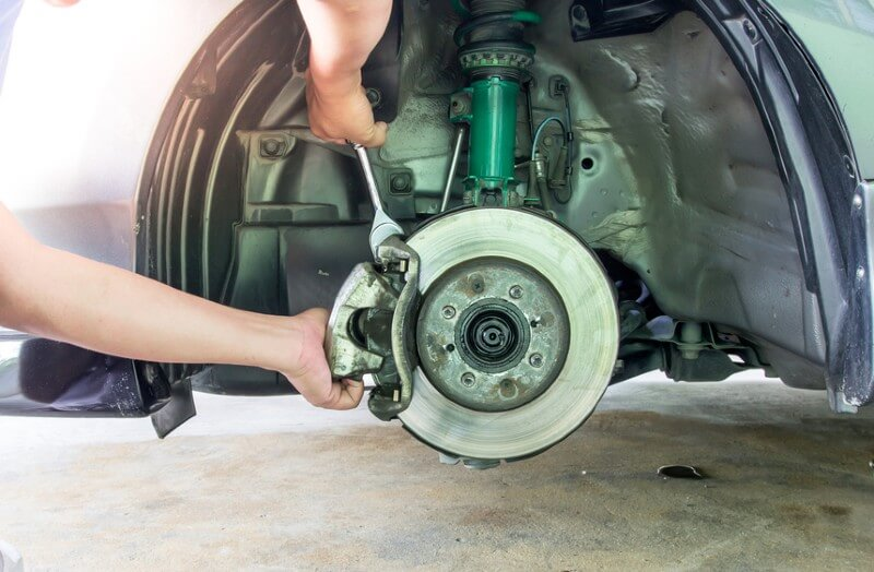 Remove caliper and brake pads