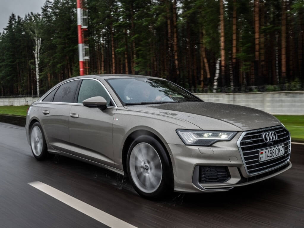 Audi A6 55 TFSI Quattro 2019 model year drives on the road