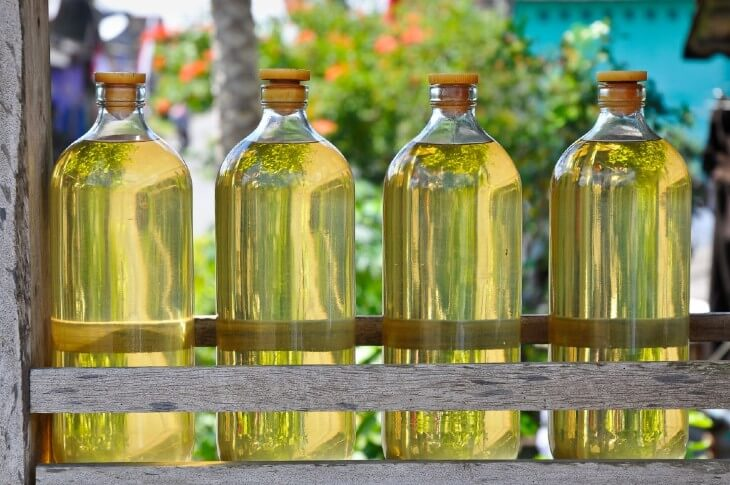 Gasoline for motorcycles is offered in glass bottles