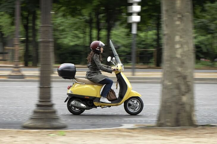 Female scooter rider in city
